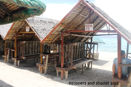 the nipa huts in the beachfront