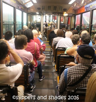 passengers inside the Peak Tram