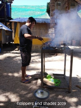 my hubby is busy grilling our food