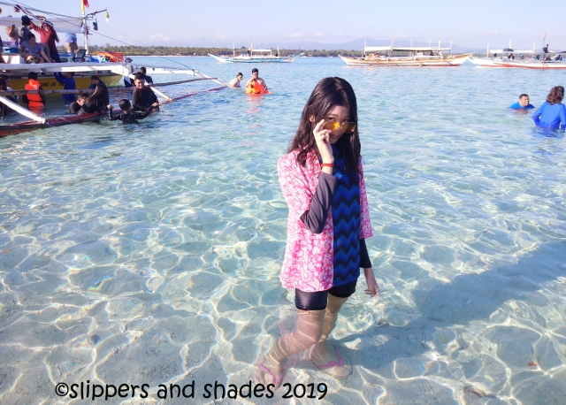the stunning clear water of Palad Sandbar truly beckons