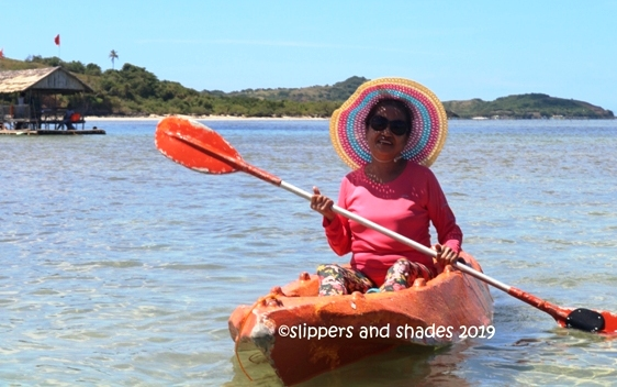 our Momshie as she paddled on the clear water